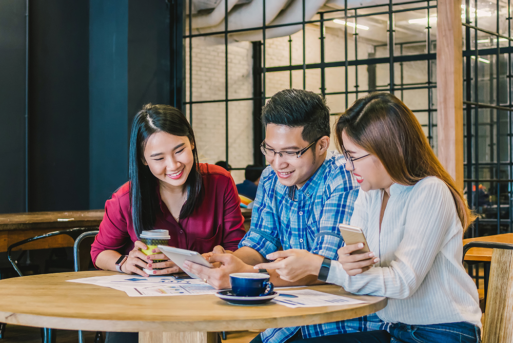 Group Of Asian Business people with casual suit brainstorm in relax action In the modern coffee shop, business group concept